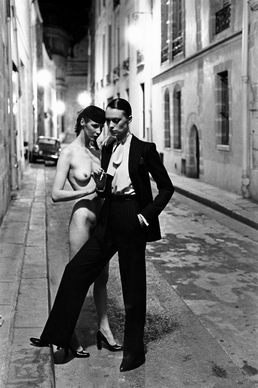 Rue Aubriot, Yves Saint Laurent, Paris, 1975.  Photo by Helmut Newton, courtesy Helmut Newton Foundation.