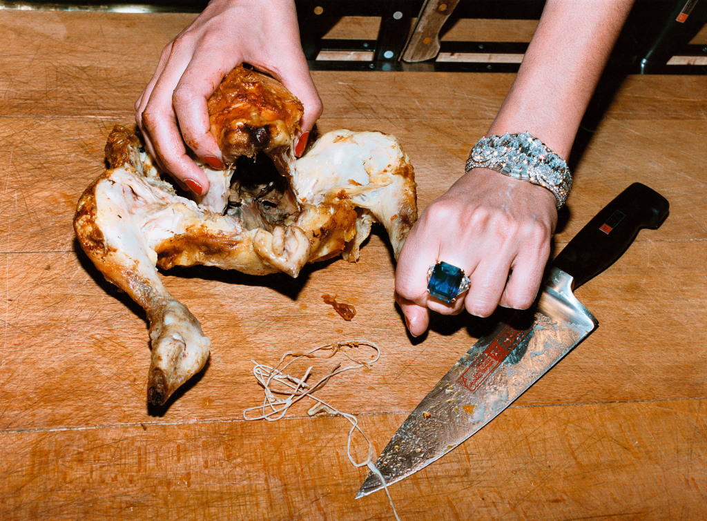 Chicken, French Vogue, Paris, 1984.  Photo by Helmut Newton, courtesy Helmut Newton Foundation.